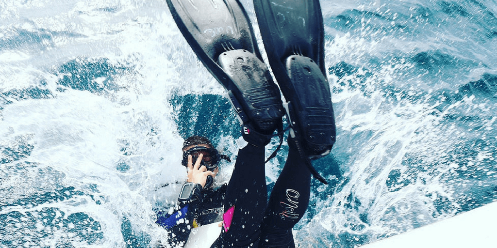 A volunteer scuba diving during a gap year adventure program.