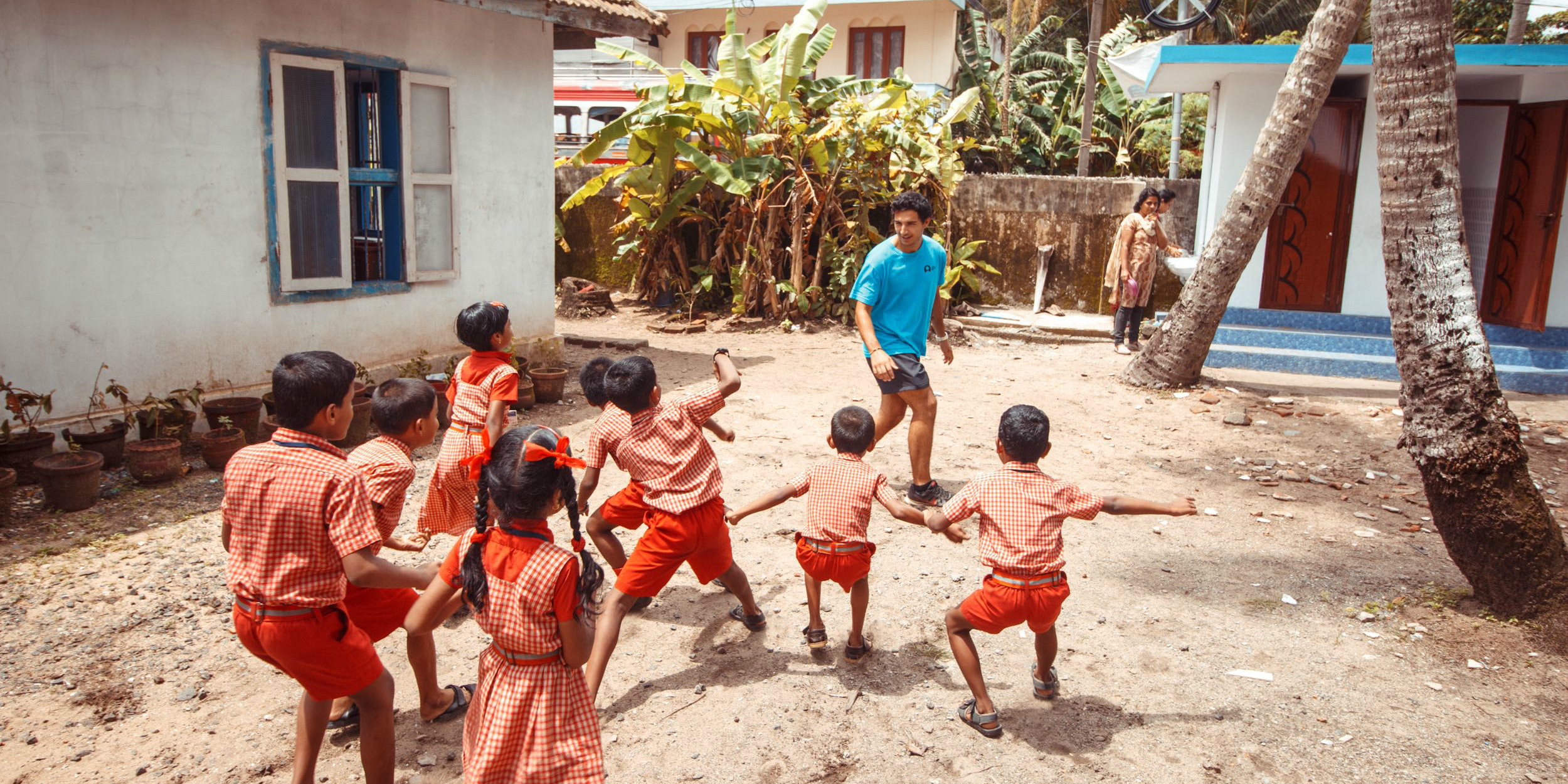 A GVI participant leads a class in sports. This international community development program focuses on health and wellness in India.