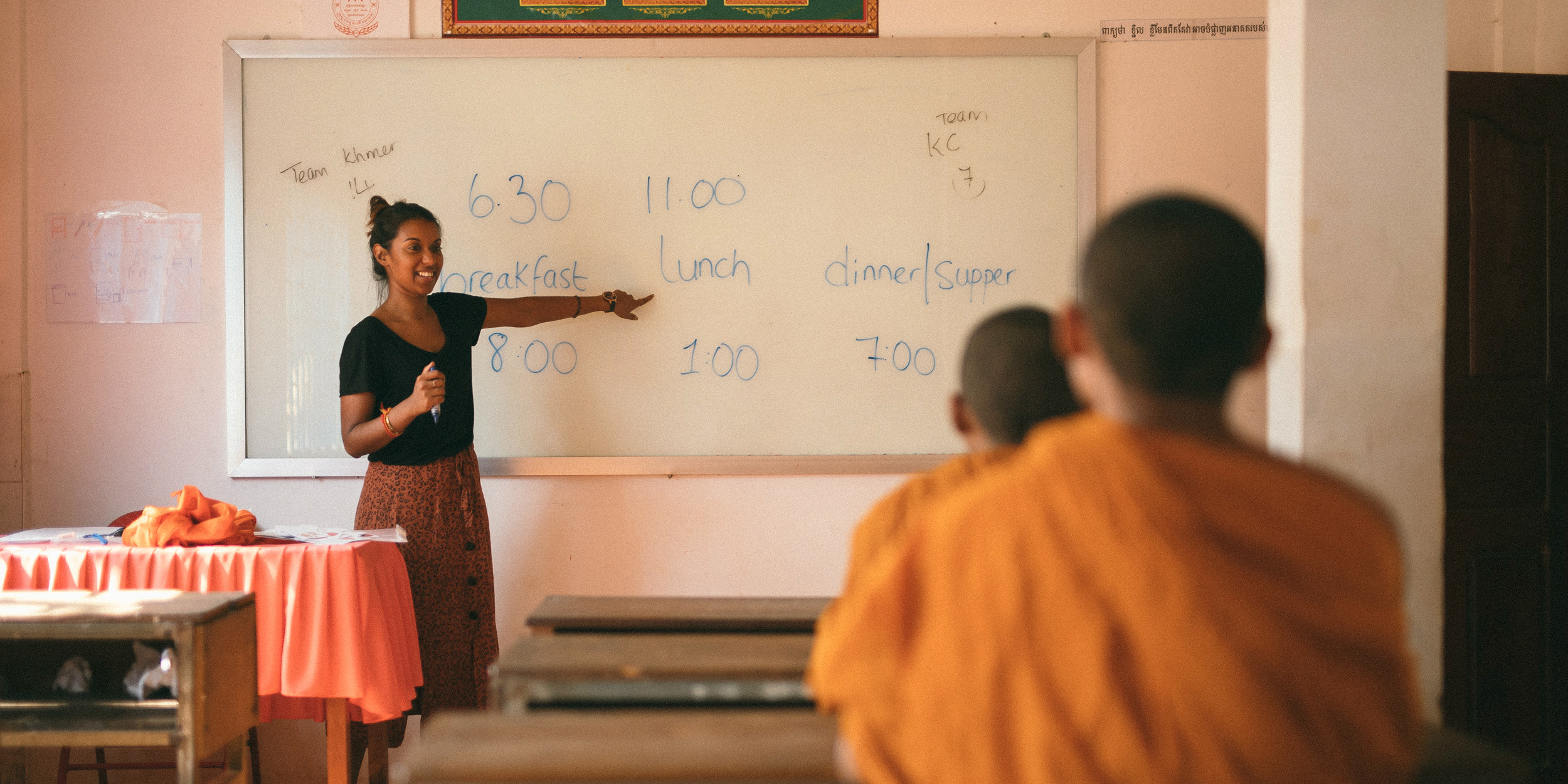 A GVI participant leads a lesson on meal times in a temple school after earning their TEFL qualification with GVI.