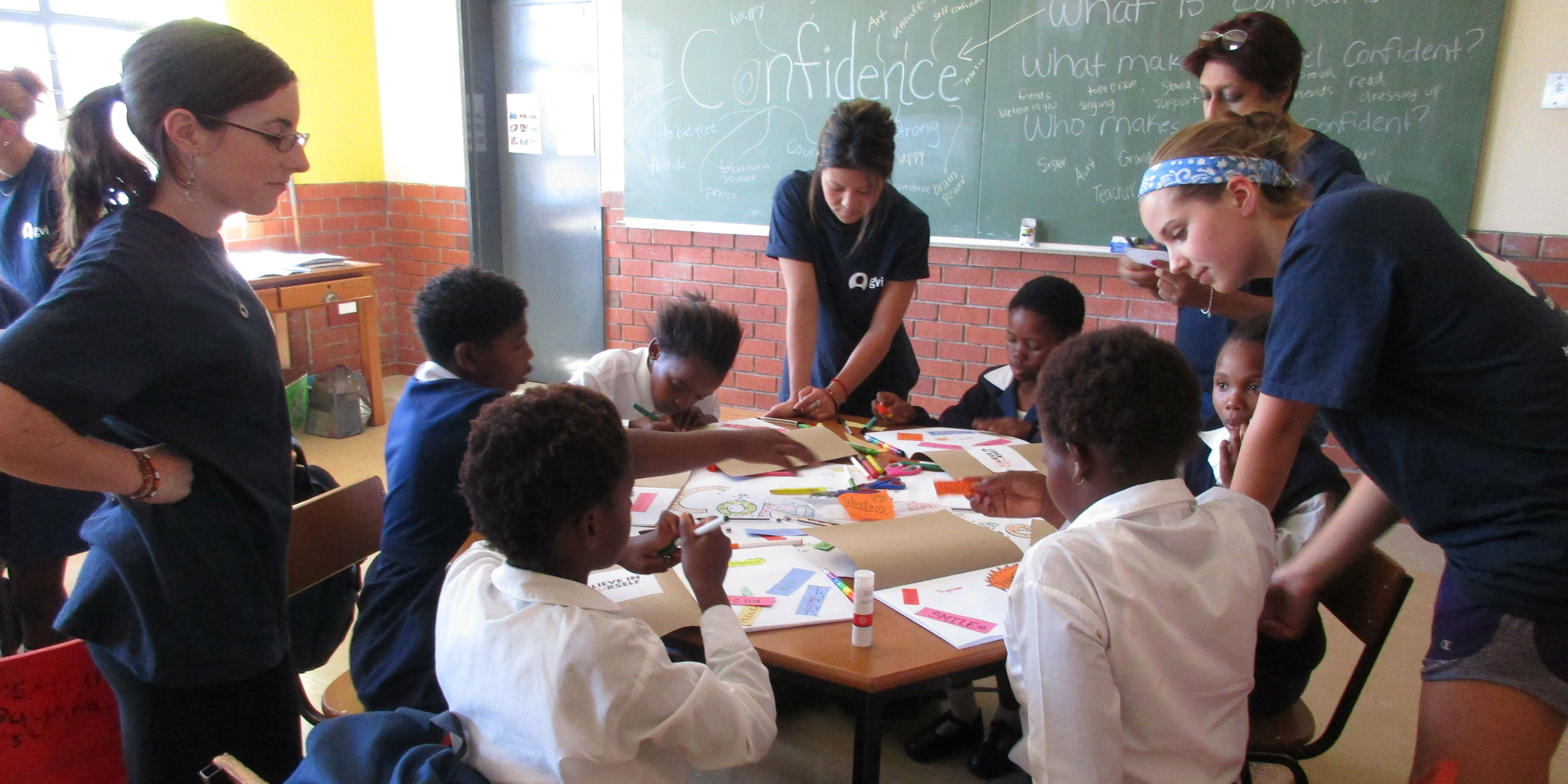 GVI participants work with a group of learners. By increasing educational capacity and support, GVI seeks to promote gender equality in education.