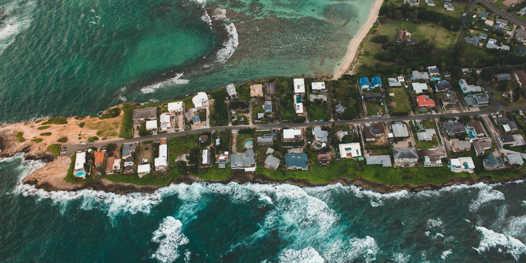 An aerial photo of houses on the coast.