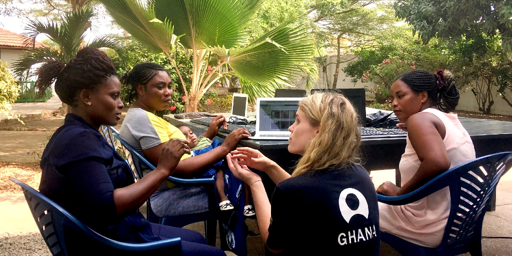 A lady teaches other women the importance of health during a public health internship.