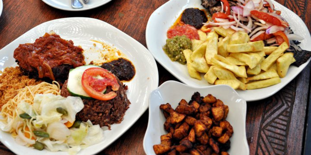 A plate full of different Ghanaian food.