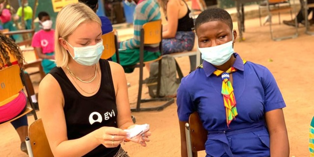 A GVI volunteer is involved in a volunteer abroad program and follows covid-19 protocols.